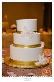 pink and gold wedding cake by west side bakery in akron ohio by