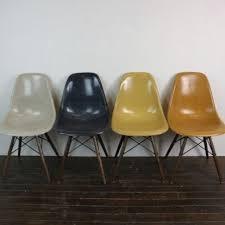 Herman Miller Charles Eames Chair Design Ideas Eames Herman Miller Dsw Side Chairs In Ochres And Navy Blue