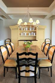 traditional dining room in yellow and black with a large hutch