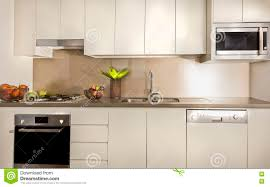 modern kitchen oven modern kitchen with pantry cupboards and counter top stock photo