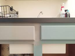 Premade Laundry Room Cabinets by Diy Ironing Board Storage And A Laundry Room Makeover