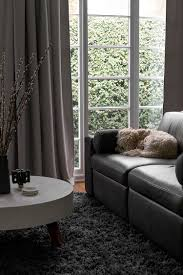 dark gray living room with display shelves grey living rooms