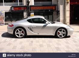 porsche cayman s sport porsche cayman s sport car parked in the city of stock