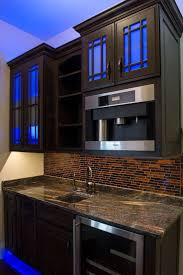 25 best kitchen lighting images on pinterest kitchen lighting small kitchen decoration using white led light under kitchen cabinet including dark brown black glass tile kitchen backsplash and black brown granite