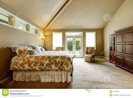 luxury house interior bedroom with high vaulted ceiling and wal