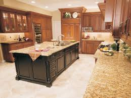 brown island with l shaped cabinetry wtih granite countertop also