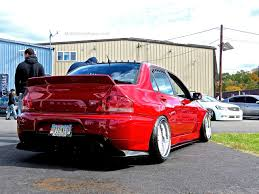 mitsubishi evo red stanced mitsubishi evo at first class fitment mind over motor