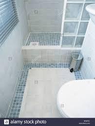 Modern Tiled Bathroom Modern Tiled Bathroom With Glass Brick Shower Wall And Blue Mosaic