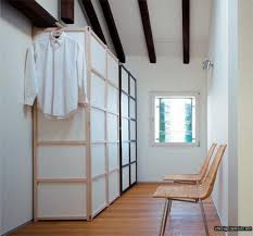 minimalist wardrobe design with external hanging cabinet and plaid
