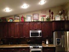decorate above kitchen cabinets above kitchen cabinets decor awesome pinterest kitchen