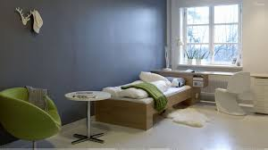 blue background and wooden bed in room wallpaper