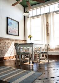 love the high windows and exposed brick chair rail and the floors