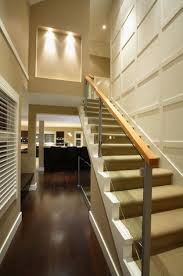 Staircase Wall Decorating Ideas How To Maximize A Staircase Wall