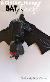 making a bat out of clothes hangers and garbage bags halloween craft