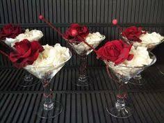 rose floating in big wine glass diy wedding centerpiece idea