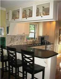 Kitchen Peninsula Cabinets Disguise A Supporting Wall Protrusion With A Kitchen Peninsula