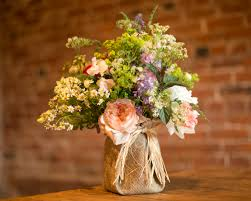 wedding flowers jam jars wedding centrepeices hessian covered jam jars and were cottage