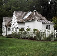 white house exterior traditional with cedar shingles white fence