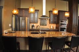 bright yellow cube glass ceiling lamp cream granite countertop two