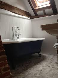 bath painted in u0027hague blue u0027 panels painted in u0027wevet u0027 both