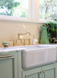 kitchen two handle bridge style faucet with side spray in