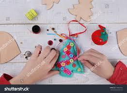 child making felt christmas tree decoration stock photo 518892592