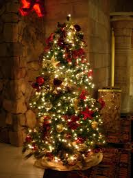 christmas tree with white lights and red bows christmas decoration wonderful holiday season tree rustic red and
