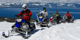 snowmobiling tour winter activity zephyr cove resort lake