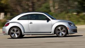 mini volkswagen beetle photos 2011 mini cooper s vs 2012 volkswagen beetle turbo
