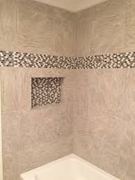 beautiful decorative bathroom tile on shower with decorative wall