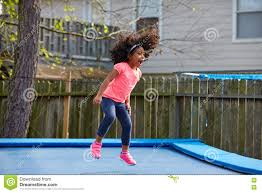 kid toddler jumping on a trampoline stock photo image 71953062