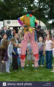 clown stilts colourful clown on stilts entertaining children moreton show