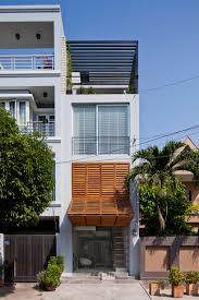narrow townhouse in vietnam by mm features a retractable shutter