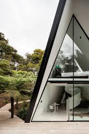 stay in a tent inspired a frame cabin in the new zealand rain