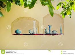 trompe l oeil fun wall mural painting in france stock photo bottles containers decor europe france fun garden glass mural painted painting shelf wall