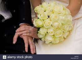 wedding flowers groom and groom with wedding flowers and rings stock photo