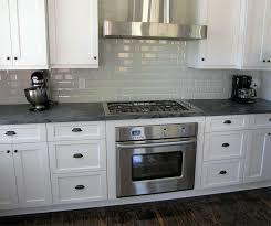 white kitchen with stove hood schoeman enterprises