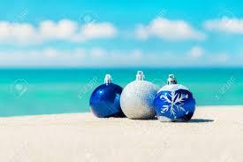 christmas tree decorations on sea beach sand winter holidays