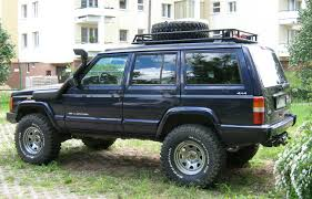 jeep station wagon lifted file jeep cherokee xj lifted blue warsaw apartment parking jpg