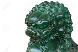 jade lion statue on white background stock photo picture