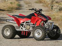 450 similar to mine but with pipe ride red honda swag