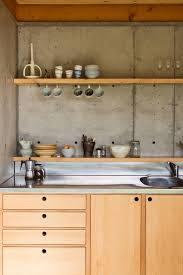 concrete slab walls and wooden bench cupboard kitchen patch