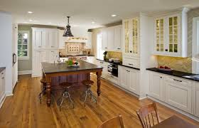 the new kitchen features custom white beaded inset cabinetry and