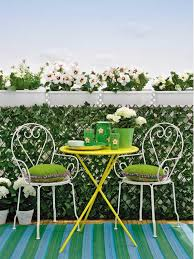 apartment green baclocy with small white chairs and green