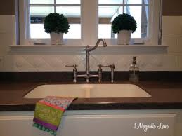 how to do a kitchen backsplash tile painted ceramic tile backsplash in my kitchen a year later 11
