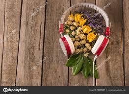 headphones and flowers on table u2014 stock photo sergpoznanskiy