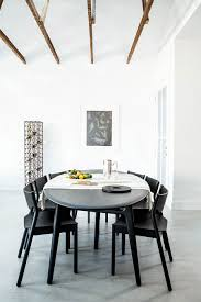 nordic influence posh bachelor pad moves away from leather and view in gallery stackable dining table chairs offer a versatile decorating arrangement inside the apartment