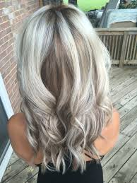 silver hair with low lights silver metallic blonde with caramel smudge low light balayage