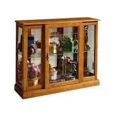 curio cabinet curio cabinets pulaski cabinet display with leons