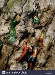 elves carved on tree in kensington gardens united